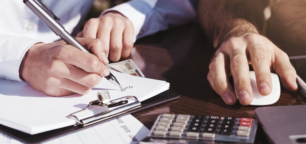 Office, business tools with dollars and calculator on table