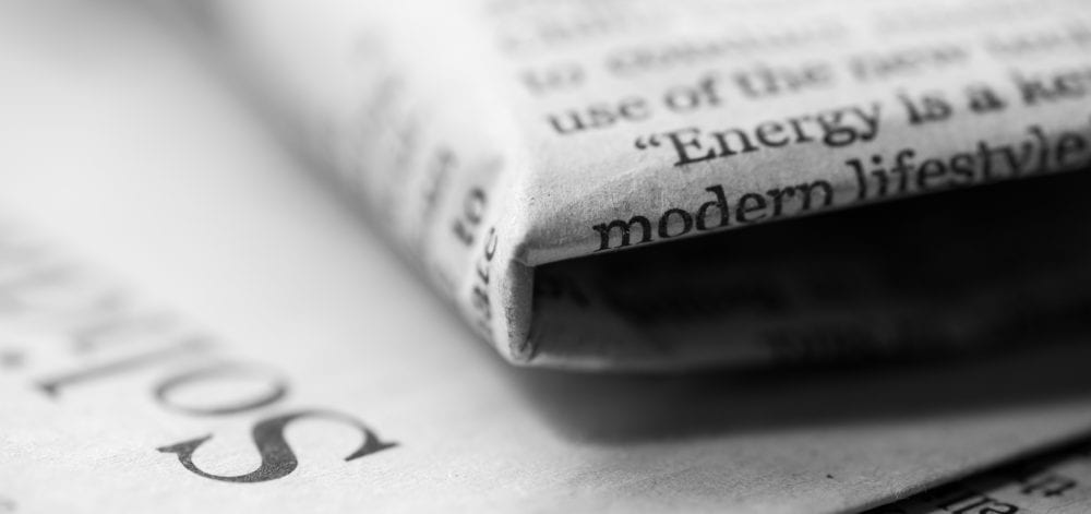 Stack of newspaper, black and white